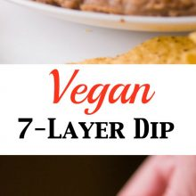 This is a infographic photo, the top part showing this vegan 7 layer dip and the bottom part showing a hand holding a chip full of dip. Text divides the two photos, illustrating this is a vegan 7 layer dip.