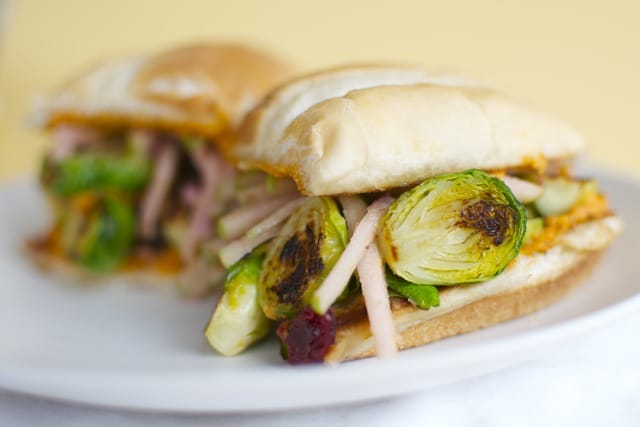 A Brussels Sprout Sandwich with Apple Slaw and Red Pepper Hummus.
