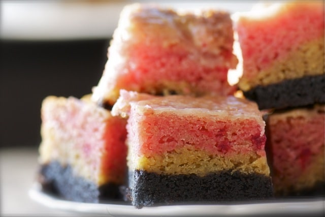 Gooey Cake Bars are made with three layers, chocolate, banana, and strawberry.