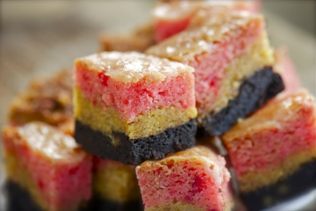 Gooey Cake Bars lined up on a plate