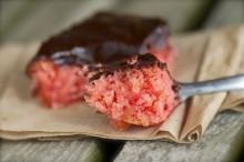 Vegan strawberry cake with chocolate fudge icing.
