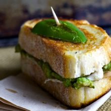 A delicious vegan sandwich with sliced jalapeños and vegan cheese