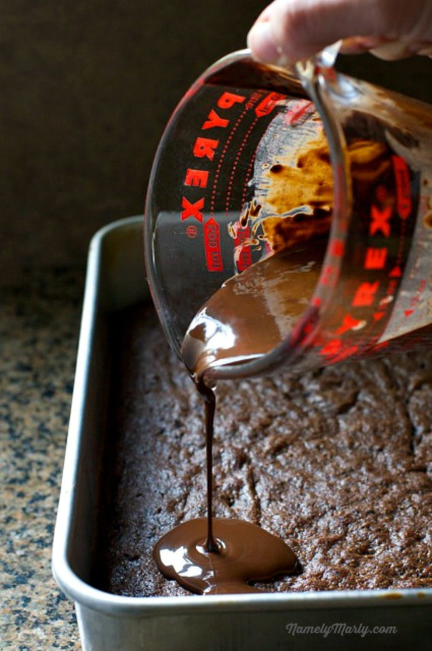 Pouring my delicious chocolate coconut mixture over my better than crack oreo brownies!