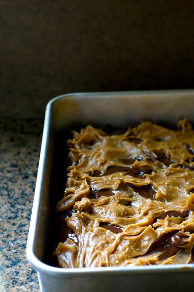 This delicious peanut butter sauce is spread all across the brownies getting ready for the next layer.