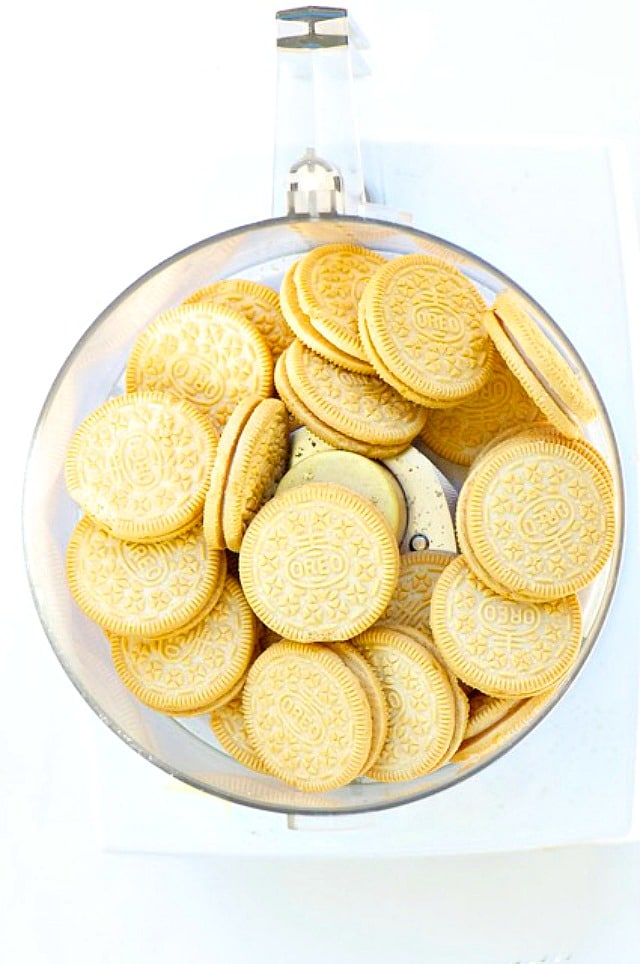 Golden Oreo Cookies in a food processor bowl.