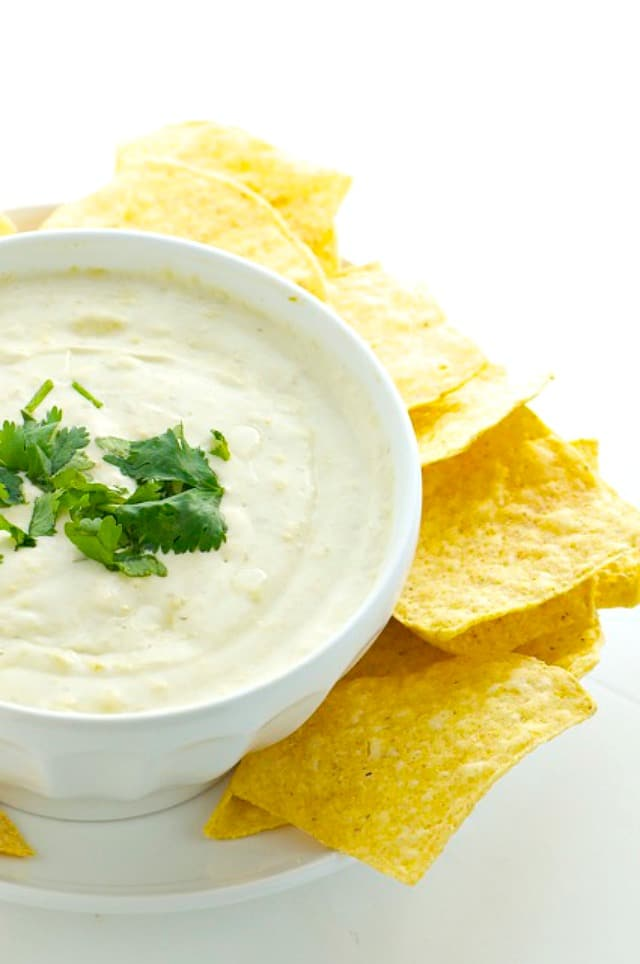 Vegan Cheese Dip is surrounded by tortilla chips and ready to serve