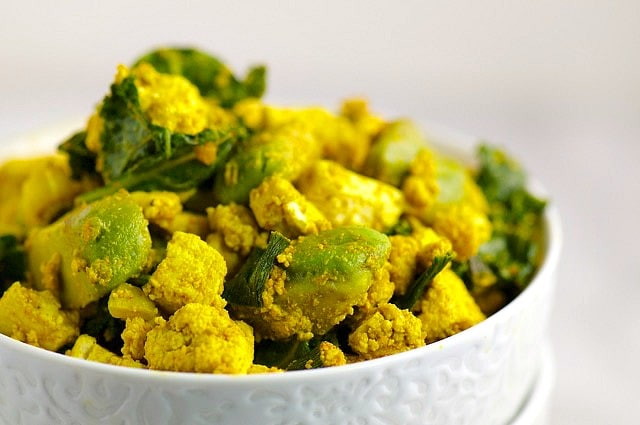 A bowl holds a generous portion of Avocado Kale and Tofu Scramble.