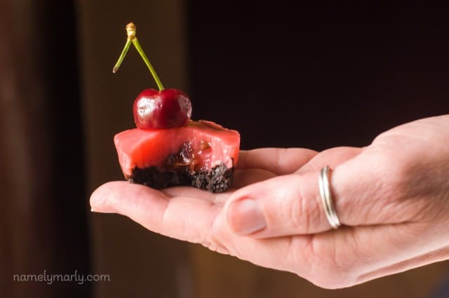 Bite-size Chocolate Cherry Jello Shots with an Oreo Crust and Vegetarian Cherry Jello filling - delicious, easy, and fun!