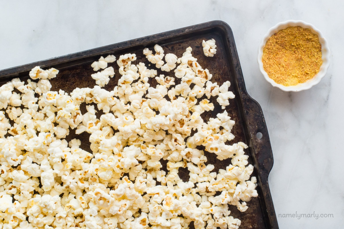Nooch Popcorn Recipe includes nutritional yeast flakes with seasonings