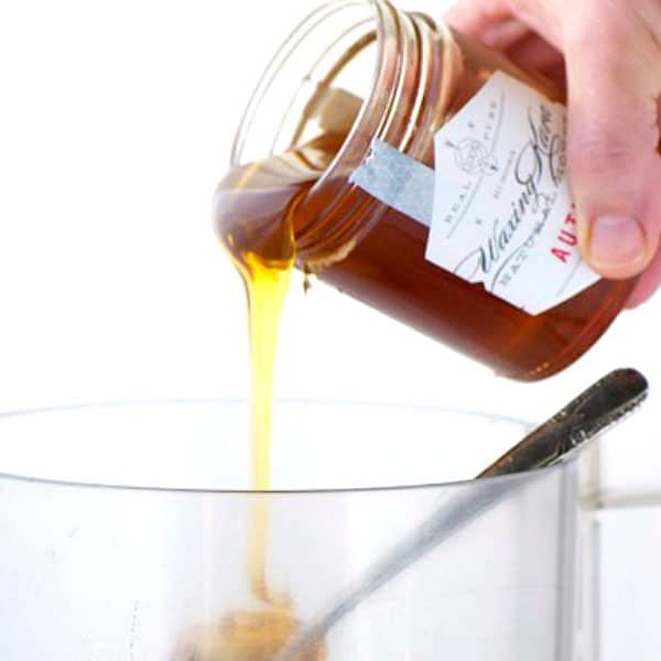 Honey pouring into a food processor cup