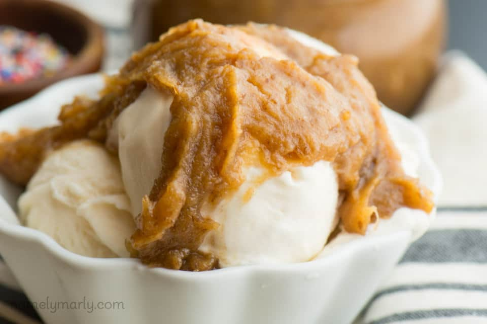 A close-up of sauce drizzled over ice cream.