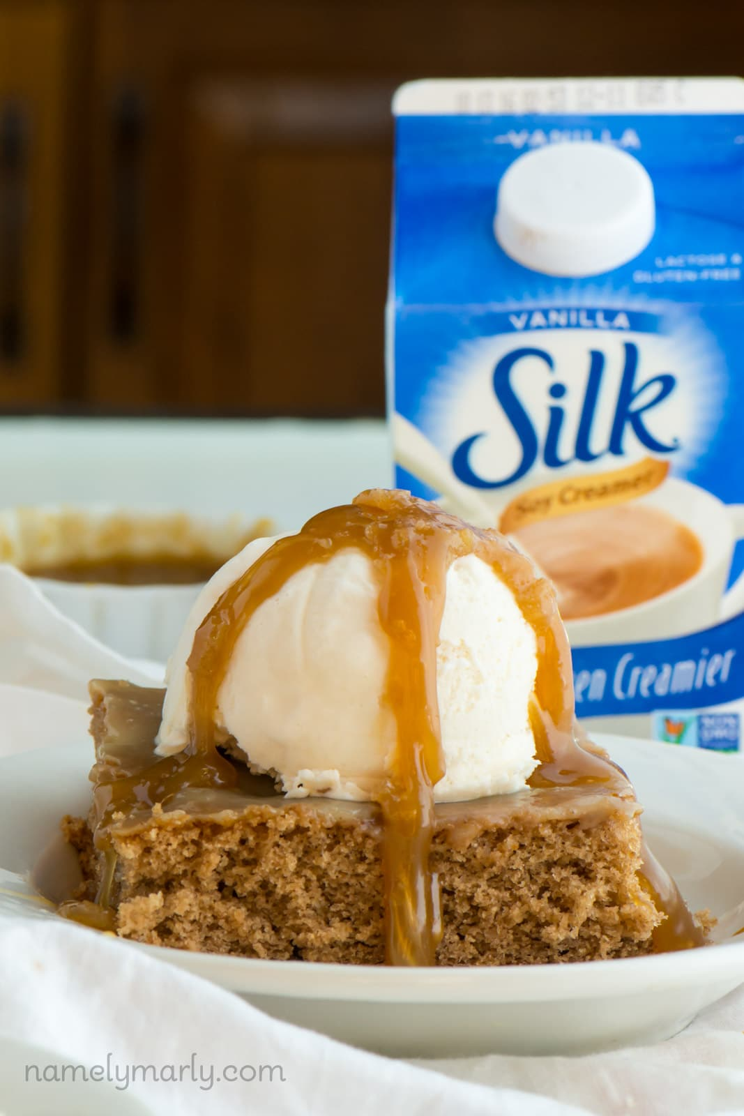Cinnamon Roll Poke Cake with Caramel Sauce