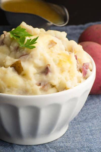 Enjoy these easy Vegan Chunky Garlic Mashed Potatoes for your holiday dinners or any time of the year! This is an easy recipe that you can make in minutes, and is made vegan with plant-based milk. We add garlic to add even more savory deliciousness to each bite!