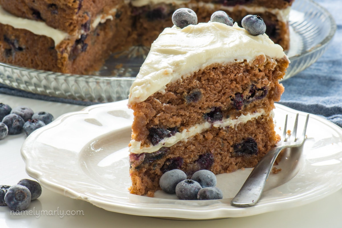 Take a bite out of this moist Vegan Blueberry Cake, made with minimal ingredients. This flavorful cake with creamy frosting is ready in around 30 minutes!