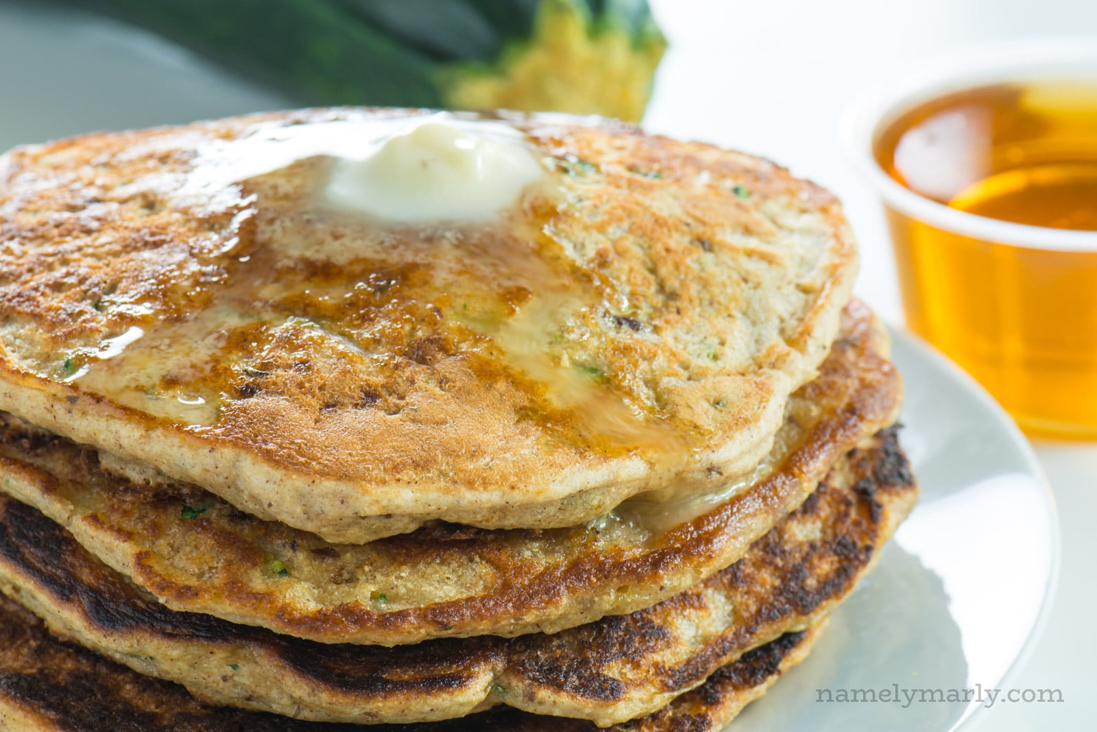 Crispy on the outside, tender on the inside, these Vegan Breakfast Zucchini Pancakes topped with maple syrup will start your day out right, time after time.