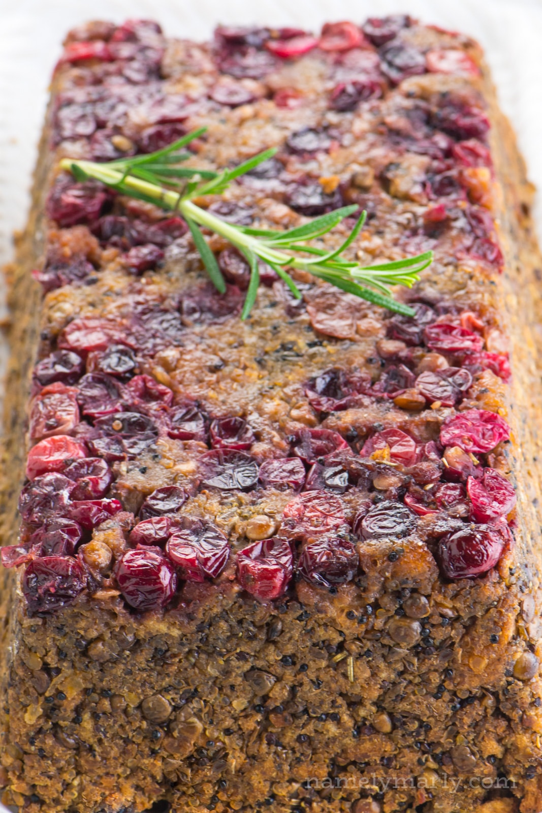 We love this vegan holiday lentil loaf with stuffing and cranberries for our Thanksgiving and Christmas holiday dinners!