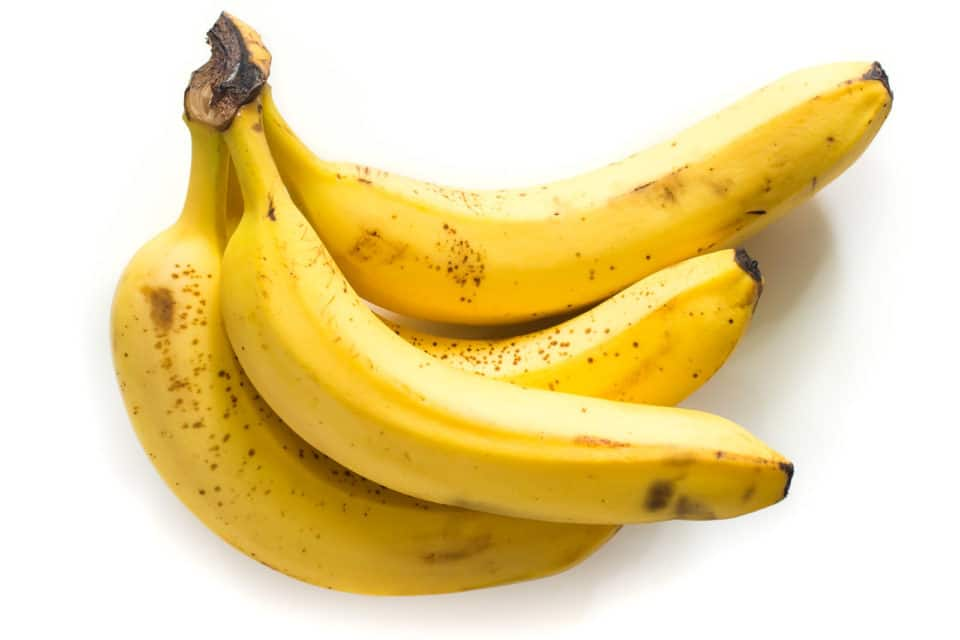 Bananas on a white counter top.