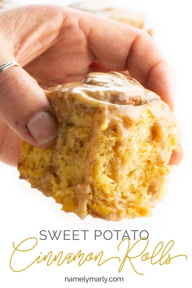 A hand holds a cinnamon roll. The text below it reads: Sweet Potato Cinnamon Rolls.