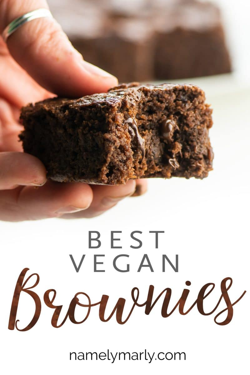 A hand holds a brownie with a bite taken out, the text below it reads: Best Vegan Brownies.