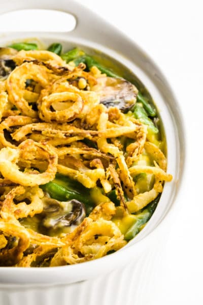 A casserole shows fried onions in a casserole dish with green beans.