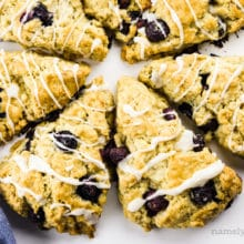 Several triangle shaped scones are pointing towards the center, create a round of scones.