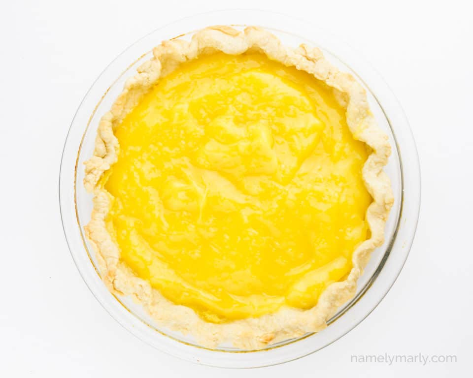 Lemon curd has been poured into a pie shell.