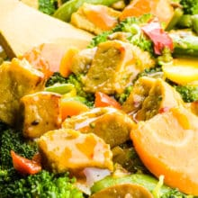 A closeup of vegan chicken in a stir fry with lots of veggies.