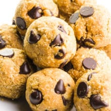 A plate holds several cookie dough bites, all with lots of chocolate chips!