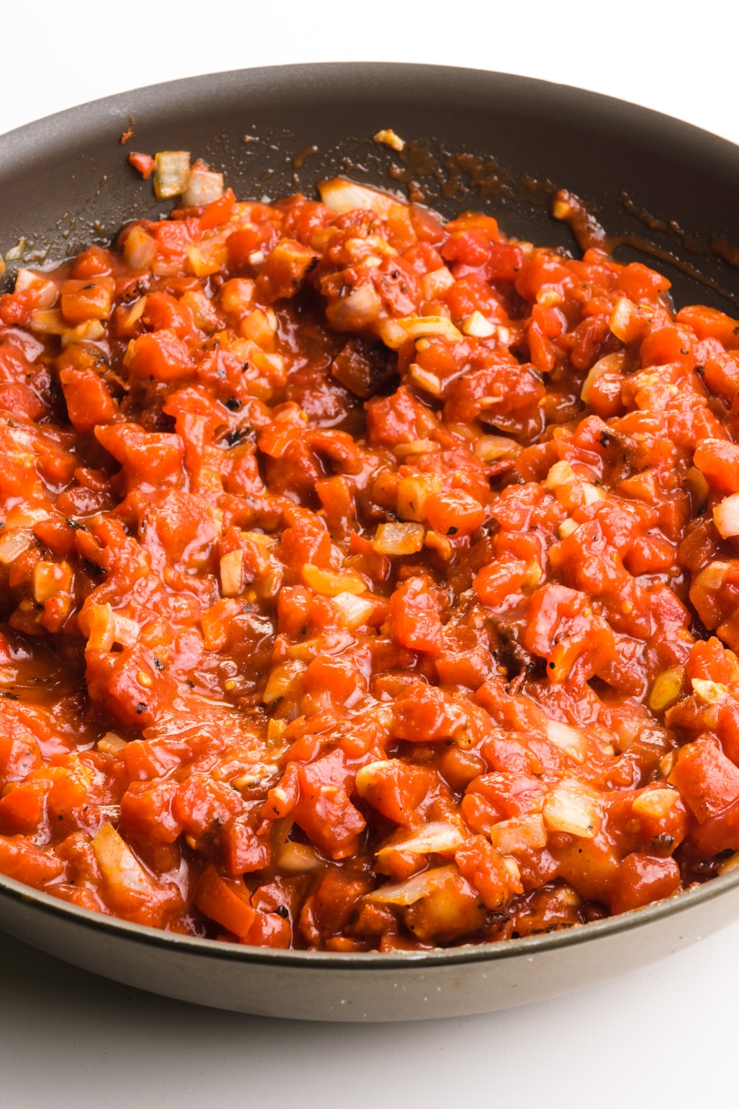A tomato-based mixture is in a skillet.