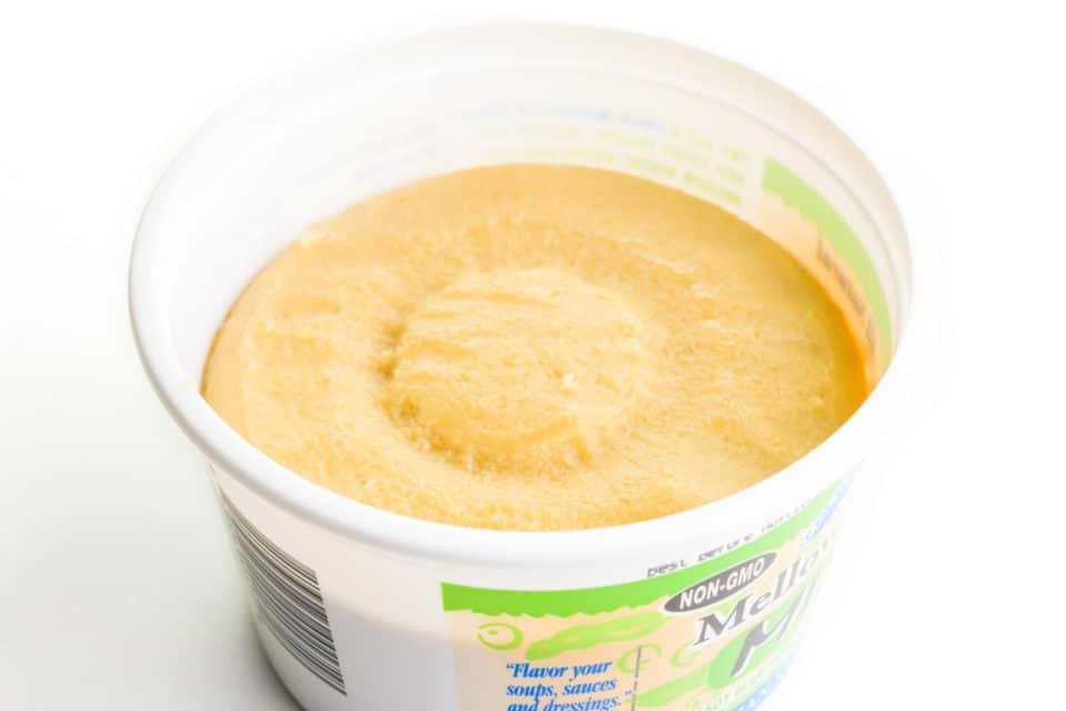 Looking into a container of mild miso paste.