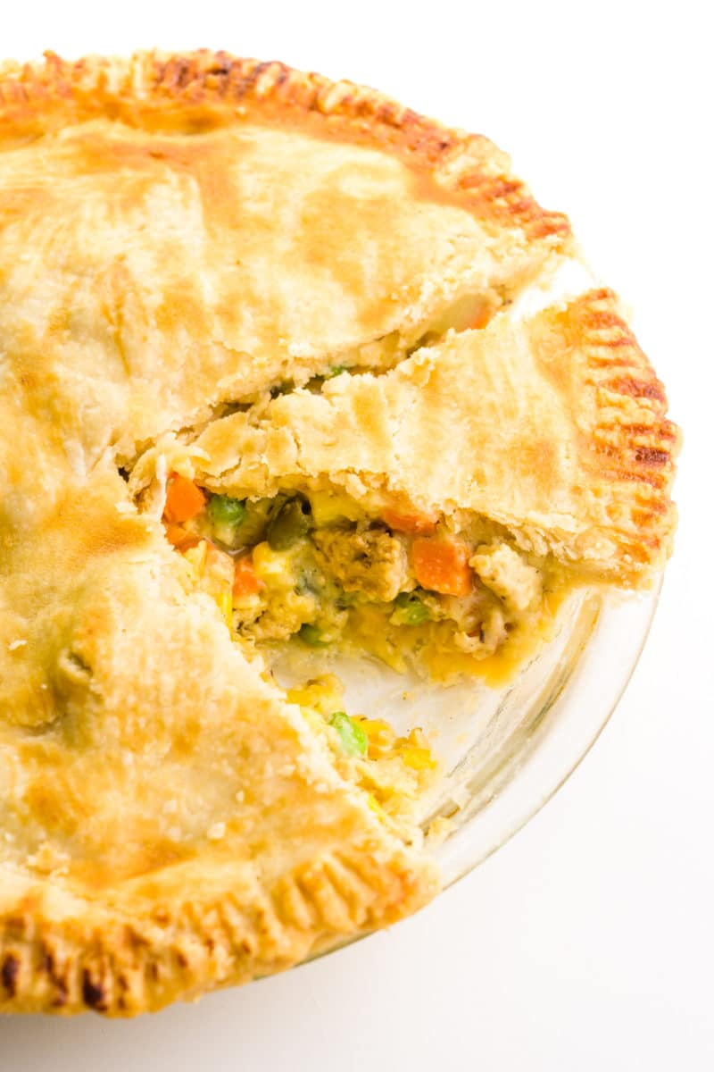 Looking down on a vegan pot pie with a slice cut out and another one cut and ready to be served.