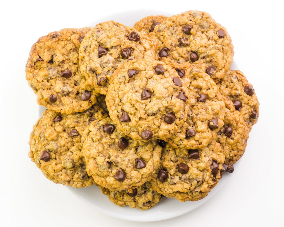 Looking down on a plate full of oatmeal chocolate chip cookies.