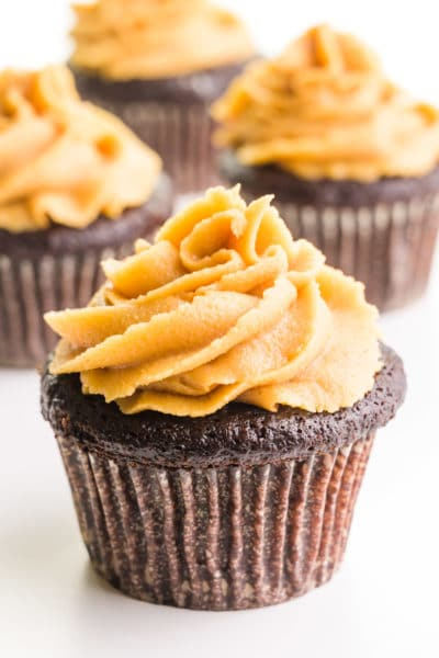 Chocolate cupcakes are topped with swirls of vegan peanut butter frosting.